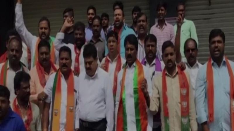 Following the death of a five-month-old infant due to fire in a hospital at Hyderabad's LB Nagar area, BJP workers led by MLC Ramchandra Rao held a protest outside the hospital demanding investigation and strict action against the culprits. (Photo: ANI)