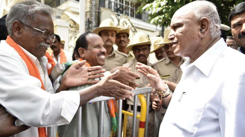 Chief Minister B.S. Yediyurappa listens to people at his residence, Dhavalagiri in Bengaluru on Wednesday.  (KPN)