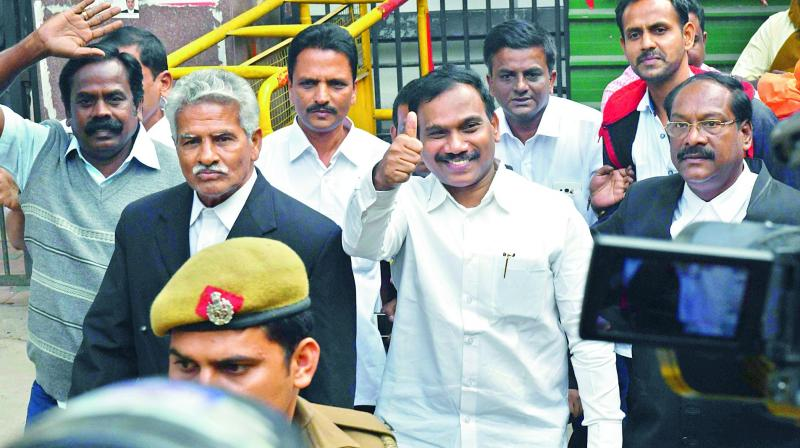 Former telecom minister A. Raja gestures after his acquittal. (Photo: PTI)