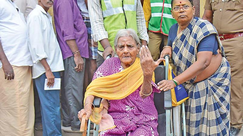 Ninety-year-old Parvathammal after casting her vote at Old Washermenpet on Thursday. (Photo: DC)
