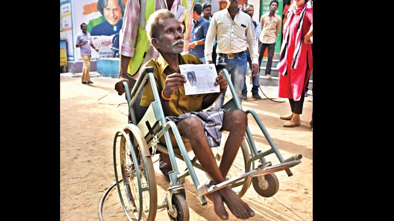 An elderly man is being wheeled into a booth in RK Nagar constituency. (Photos: N. SAMPATH and E.K. SANJAY)