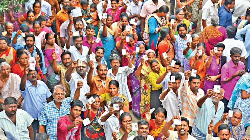 Voters display their ID cards at Tondiarpet polling booth. (Photo: DC)