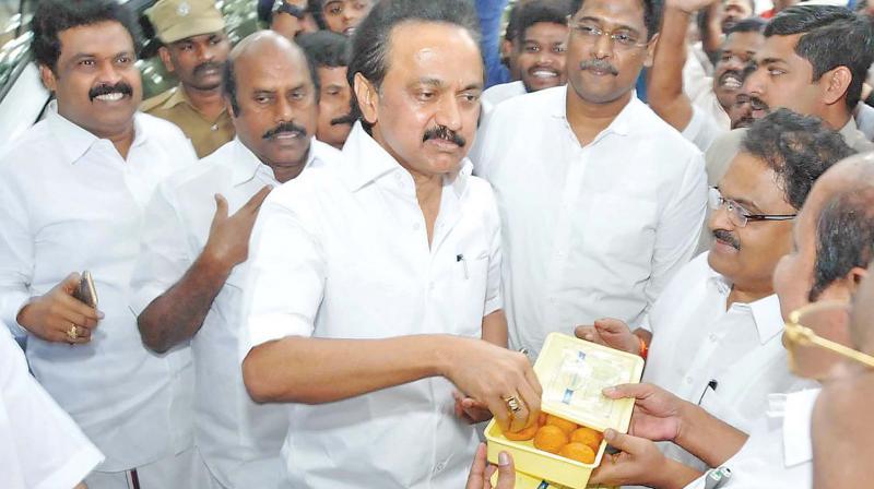DMK working president M.K. Stalin celebrates with party cadres in Chennai on Thursday. (Photo: DC)