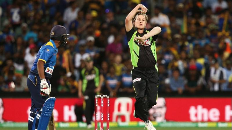 Adam Zampa, who replaced Andrew Tye for the dead rubber, had in form Asela Gunaratne (4) lbw and then accounted for the wickets of Chamara Kapugedera and Dasun Shanaka in one over. (Photo: AFP)