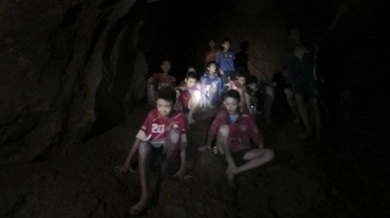 The Thai footballers, aged 11-16, have been stuck in darkness deep underground after setting off to explore the cave with their 25-year-old coach after training on June 23. (Photo: AP)