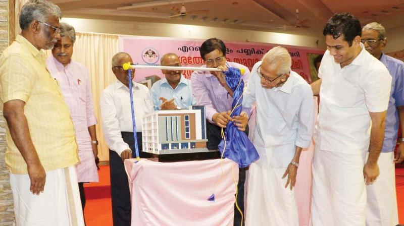 Prof M.K. Sanu inaugurates the construction of the new building of Ernakulam Public Library which is celebrating its 150th anniversary, on Saturday. Hibi Eden, MP, and John Fernandez, MLA, are also seen. (Photo: DC)
