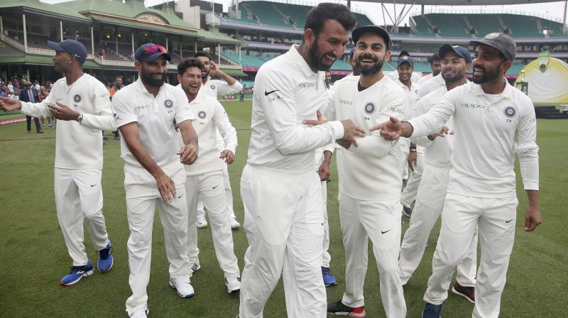 While player of the series Cheteshwar Pujara was seen dancing with his teammates, Kohli uploaded a celebratory post in Twitter. (Photo: AP)