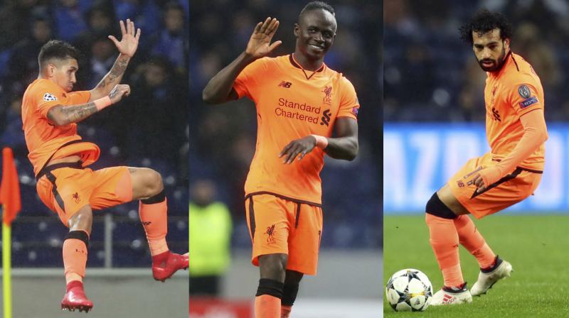 While Sadio Sane hammered three goals, Mohamed Salah, who scored his 30th goal of the season, and Roberto Firmino scored a goal each to complete Liverpool's Porto thrashing. (Photo: AP)