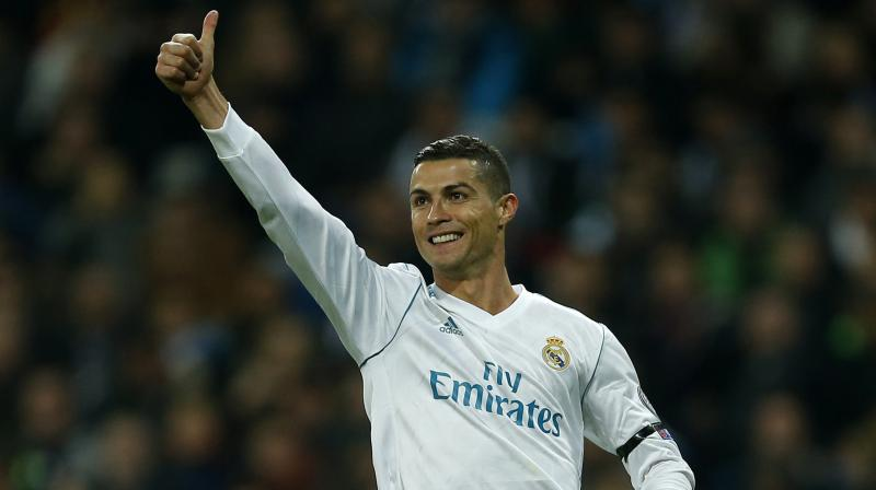Real Madrid star Cristiano Ronaldo has been named Globe Soccer's Best Player for the second year in a row and the fourth time overall although he wasn't present in person to receive his trophy.(Photo: AP)