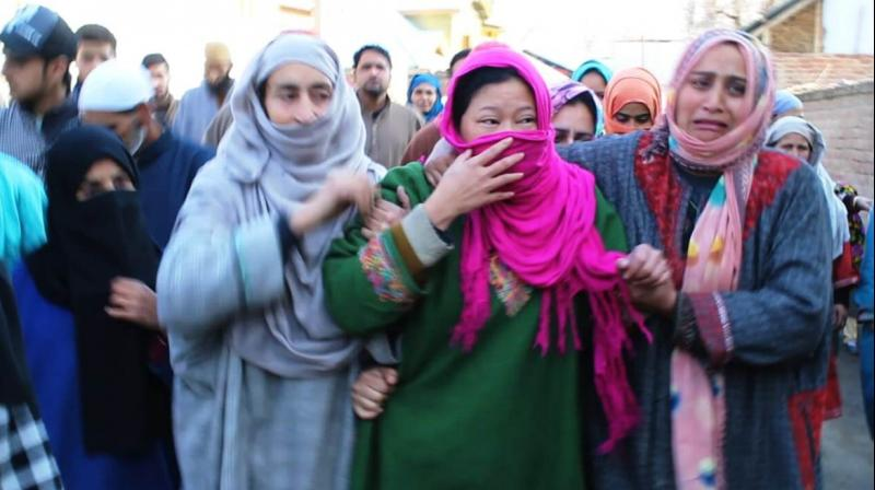 Saima (centre), wife of slain Abid Hussain Lone, being consoled by local women in J&K's Pulwama. (Photo: Kashmir Life)