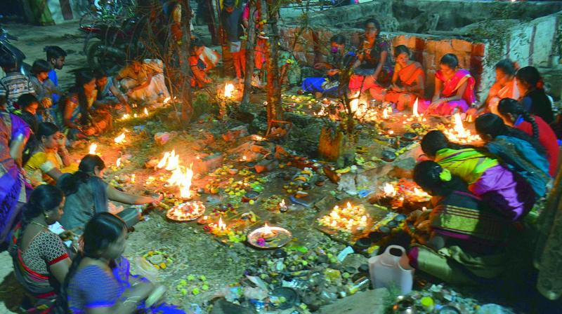 Women perform puja by lighting earthen lamps on Kartika Pournami at a temple in Musheerabad on Friday. The full moon day in the Hindu month of Kartika is considered to be auspicious day by the devotees of both Lord Shiva and Lord Vishnu.  (DC)