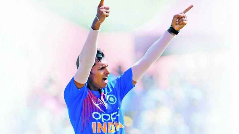 Navdeep Saini celebrates a Windies wicket during the first T20 in Florida.  (Photo: AFP)