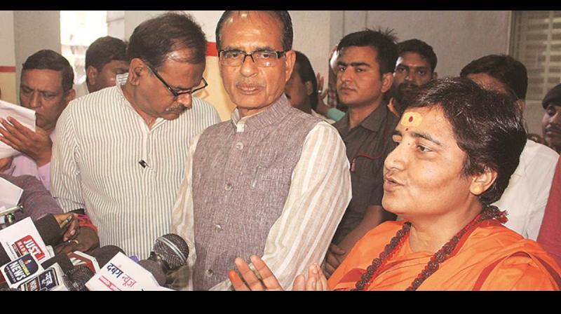 Sadhvi Pragya Singh Thakur along with Shivraj Singh Chouhan after announcing Sadhvi Pragya Thakur as the BJP's candidate for Bhopal. (Photo: PTI)