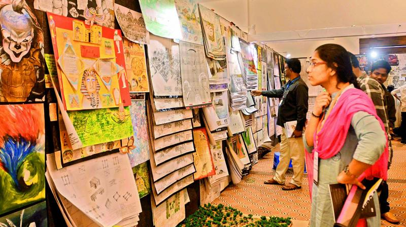 Students admire the designs on display at the Amaravati Design Festival-2019 at the CK Convention, Mangalagiri, near Vijayawada on Friday. (Photo:  Ch. Narayana Rao)
