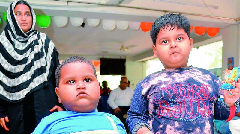 Two year-old Sk.Tabish (Wt: 32 kg) and five-year-old Sk. Sufia (Wt 42 kg) suffer from leptin deficiency and seek government's help for treatment. (Photo: DC)