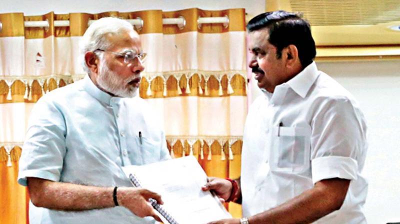 Prime Minister Narendra Modi receives a memorandam from Chief Minister Edappadi K. Palaniswami during his visit to the Cyclone Ockhi-hit areas, in Kanyakumari on Tuesday. (Photo: PTI)
