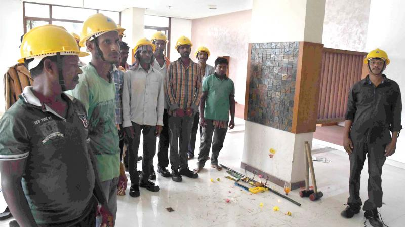 Demolition workers offer prayers at Alfa Serene apartment at Maradu in Kochi on Thursday. (Photo: DC)