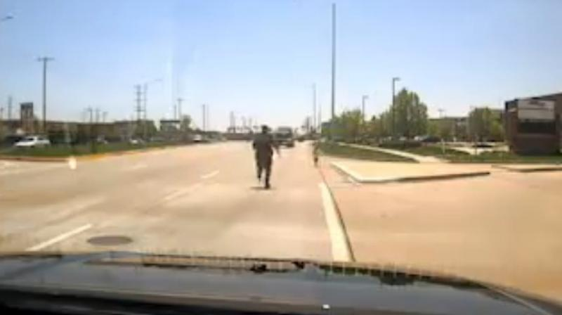 Brave police officer rescue toddler from oncoming traffic. (Photo: Facebook / Naperville Police Department)