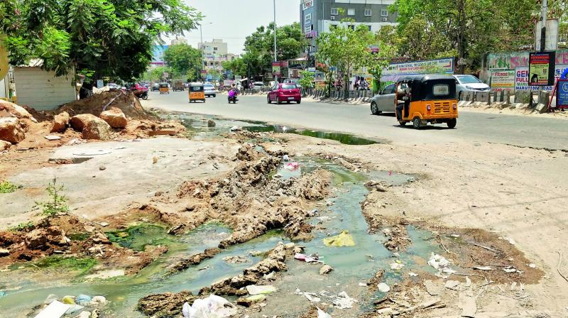 Sewage overflow on to the road after construction of a box drain near Kondapur RTA office stopped. (Photo: DC)