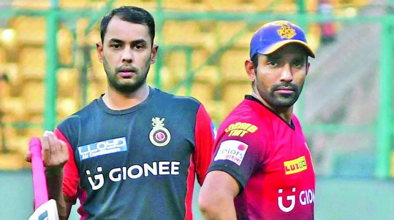 Stuart Binny (left) of RCB and Robin Uthappa of KKR during a training session on Saturday.(Photo: R. Samuel)