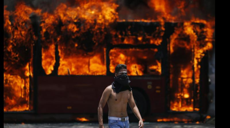 Rioters later blocked the highway with a bus and set it on fire. (Photo: AP)