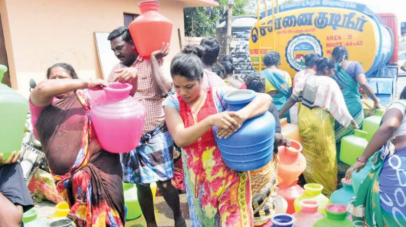 A scene from Triplicane where people rush to get a pot of water.   (DC)