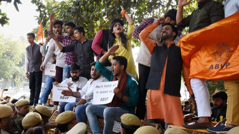 Akhil Bharatiya Vidyarthi Parishad (ABVP) activists during a protest against Delhi Police at Police headquarters in New Delhi on Wednesday. The activists alleged that appropriate action was not taken in the JNU's 'anti-India' slogans case. (Photo: PTI)