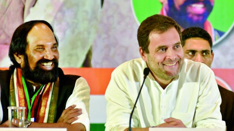 Congress president Rahul Gandhi and TPCC president N. Uttam Kumar Reddy addressing the media in Hyderabad on Wednesday.  (S. Surender Reddy)
