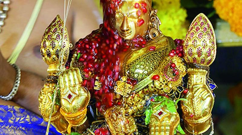 The processional deity of Sri Padmavathi Devi is decked with fruits and floral garland.