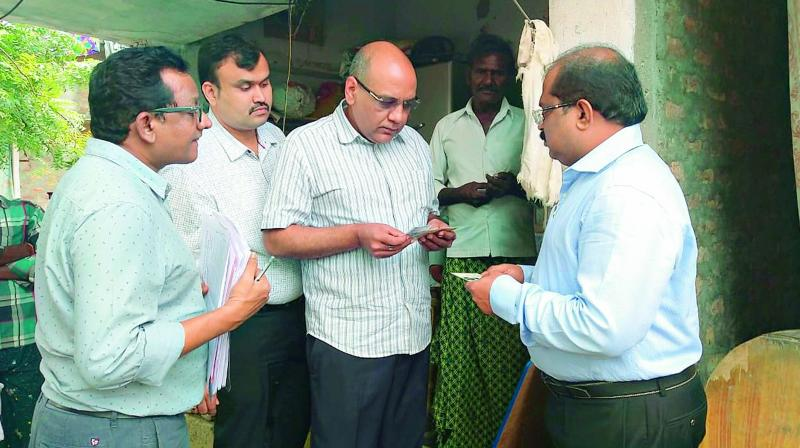 AP state chief electoral officer R.P. Sisodia and his team conducts field inquiry on fake voters registration in Ganapavaram village in Guntur district on Wednesday. (DC)