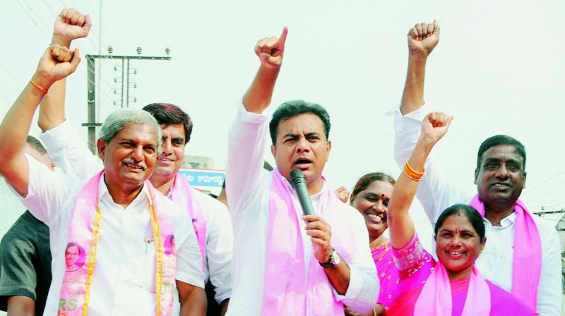 Minister K.T. Rama Rao participates in road show as part election campaign at Vemulawada in Rajanna Sircilla district  on Wednesday.  (DC)