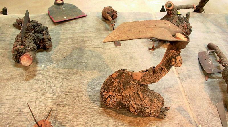 Sculptural works made of discarded tools and diseased barks of trees.