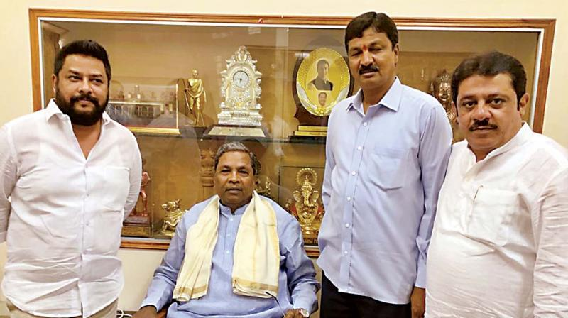 Legislators B. Nagendra and Ramesh Jarkiholi with Congress Legislature Party leader Siddaramaiah and minister Zameer Ahmed Khan.