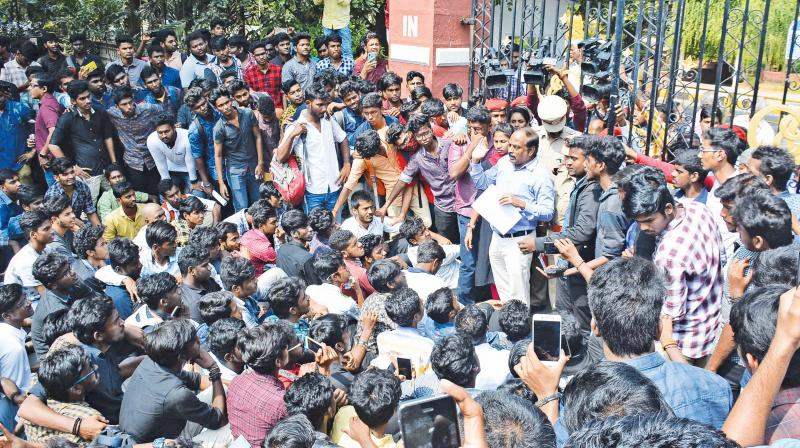 Anna University registrar J. Kumar addressing the protesting engineering students outside the university campus in Guindy on Friday. (Image DC)
