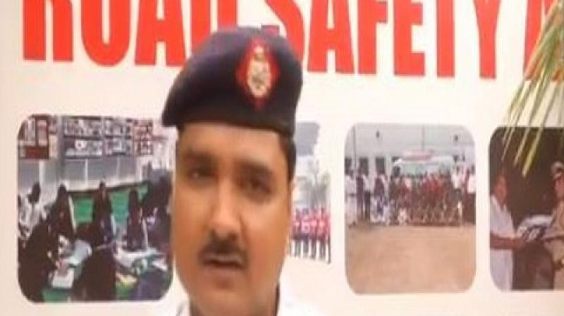 The cop also buys helmets from his own pocket and gifts it to others. Till date, he has circulated around 700 helmets to people. (Photo: ANI | Twitter)