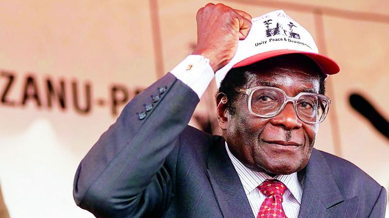 In this file photo taken on July 28, 2013, Zimbabwe's former president Robert Mugabe greets supporters after his address at a rally in Harare. (Photo: AFP)