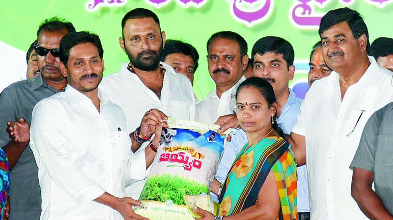 Chief Minister Y.S. Jagan Mohan Reddy distributes rice bags to women in Srikakulam on Friday. (Photo: DC)