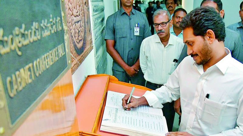 In this file photograph Chief Minister Y.S. Jagan Mohan Reddy signs the register during the first Cabinet meeting at secretariat in Velagapudi.