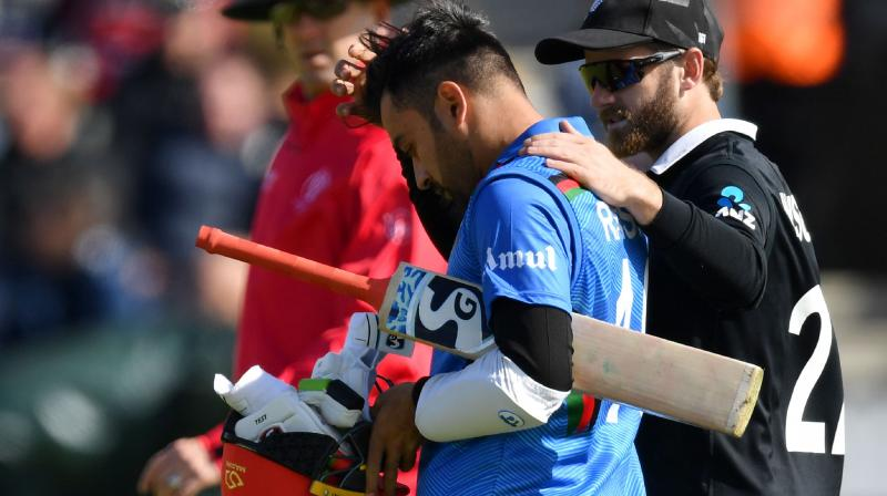 Rashid underwent a concussion test and thereafter it was decided that he would not take the field for the remainder of the game. (Photo: AFP)