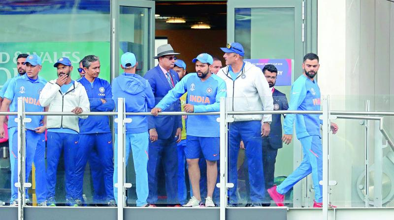 Members of the Indian team are distraught at the Old Trafford pavilion after being knocked out of the World Cup by New Zealand in the first semifinal at Manchester on Wednesday. (Photo: AP)