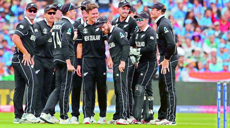 New Zealand players celebrate the dismissal of Indian captain Virat Kohli during the World Cup first semifinal at Old Trafford in Manchester, England, on Wednesday. New Zealand won by 18 runs. (Photo: AP)