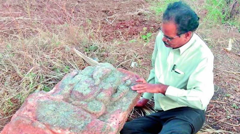 Archaeologist E. Sivanagi Reddy with the Ganesha idol.