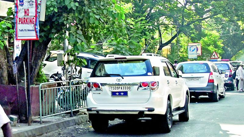 A top police officer's car is parked right in front of a No Parking signboard near the Mahankali traffic police station on Thursday. (S. Surender Reddy)