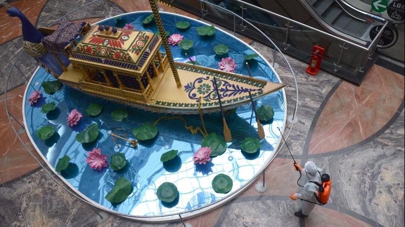 A worker sanitises the fountain in the atrium of the Phoenix Market City, Kurla in Mumbai ahead of the August 5 reopening. (DC Photo: Rajesh Jadhav)