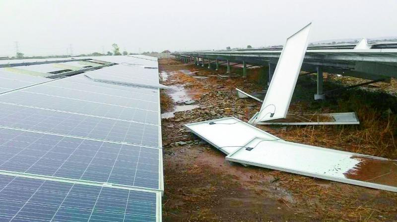 Solar panels blown away by heavy winds lie scattered in Kurnool on Tuesday. (Photo: DC)