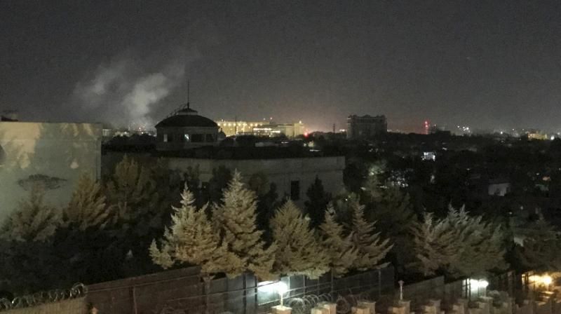 A plume of smoke rose over central Kabul shortly after midnight and sirens could be heard. (Photo: AP)