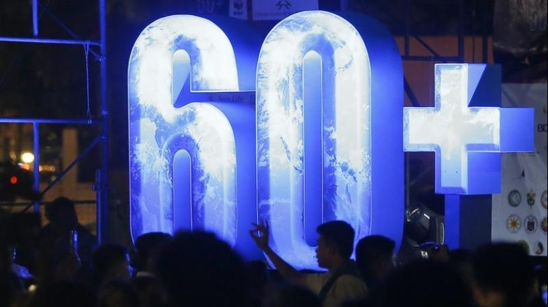 In countries around the world, at 8:30 p.m., people were switching off their lights for Earth Hour. (Photo: AP)