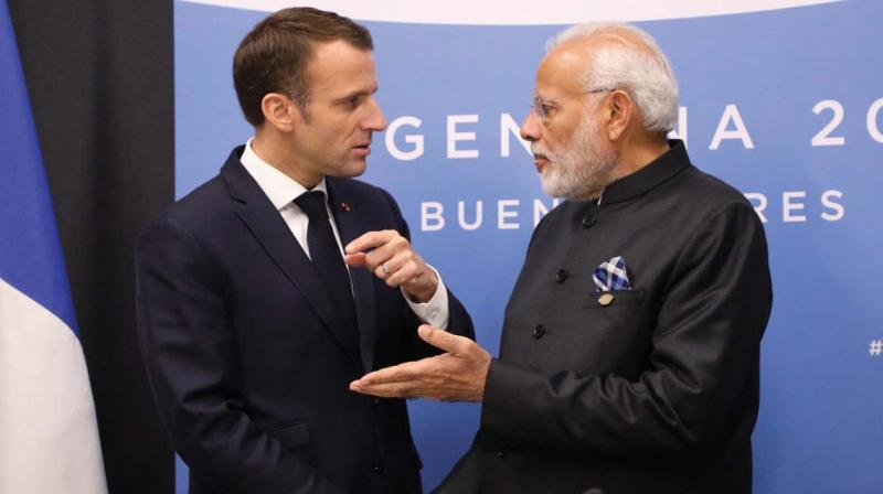 France's President Emmanuel Macron and Prime Minister Narendra Modi speak during a bilateral meeting on the second day of the G-20 Leaders' Summit in Buenos Aires on December 1, 2018 (Photo: AFP)
