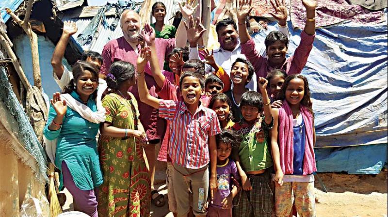Mr Kjetil Utne (centre) poses for a fun photo with kids