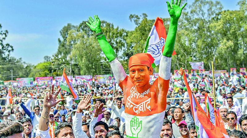 Congress supporters during a Parivartan Rally in Dehradun on Saturday.  (PTI)